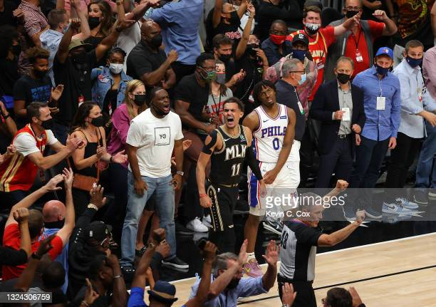 Trae Young of the Atlanta Hawks reacts after hitting a three-point basket against Tyrese Maxey of the Philadelphia 76ers during the second half of...