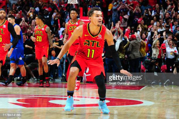 Trae Young of the Atlanta Hawks reacts after hitting the game winning 3 pointer against the Orlando Magic on October 26 2019 at State Farm Arena in...