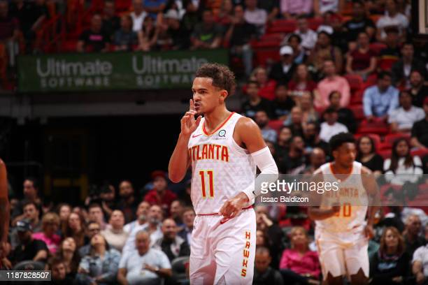 Trae Young of the Atlanta Hawks reacts to a play during a game against the Miami Heat on December 10 2019 at American Airlines Arena in Miami Florida...