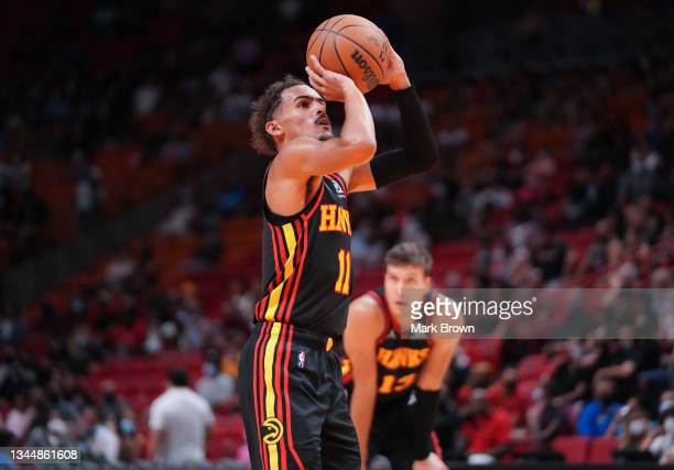 Trae Young of the Atlanta Hawks shoots a free throw in the second quarter against the Miami Heat in preseason action at FTX Arena on October 04, 2021...