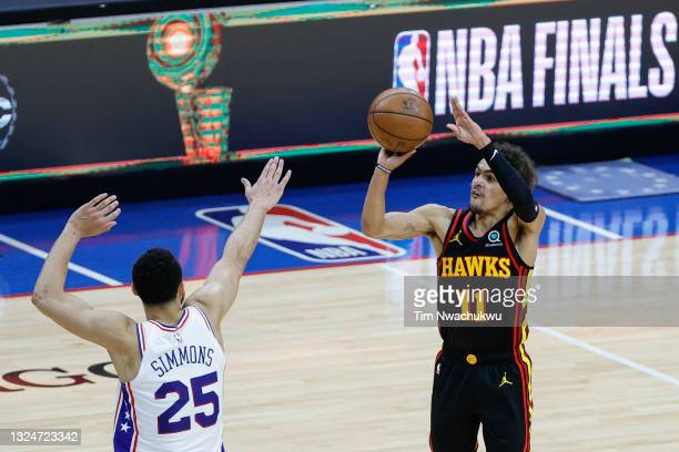 Trae Young of the Atlanta Hawks shoots over Ben Simmons of the Philadelphia 76ers during the fourth quarter during Game Seven of the Eastern...