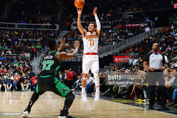 Trae Young of the Atlanta Hawks shoots the ball against the Boston Celtics on November 23 2018 at State Farm Arena in Atlanta Georgia NOTE TO USER...