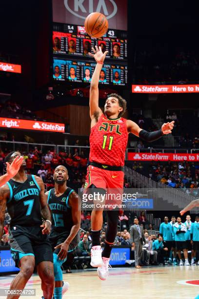 Trae Young of the Atlanta Hawks shoots the ball against the Charlotte Hornets on November 25 2018 at State Farm Arena in Atlanta Georgia NOTE TO USER...