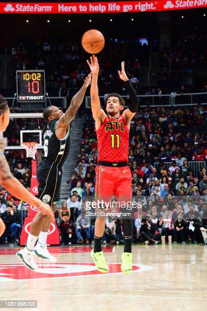 Trae Young of the Atlanta Hawks shoots the ball against the Milwaukee Bucks on January 13 2019 at State Farm Arena in Atlanta Georgia NOTE TO USER...