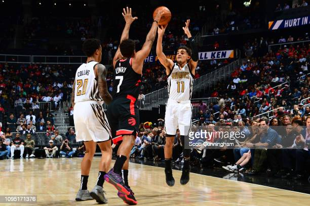 Trae Young of the Atlanta Hawks shoots three point basket against the Toronto Raptors on February 7 2019 at State Farm Arena in Atlanta Georgia NOTE...