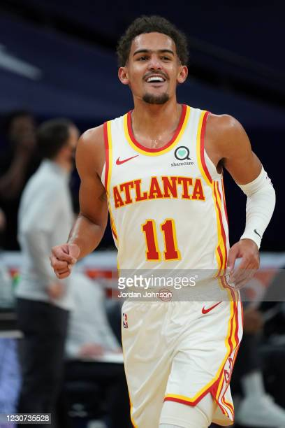 Trae Young of the Atlanta Hawks smiles during the game against the Minnesota Timberwolves on January 22, 2021 at Target Center in Minneapolis,...
