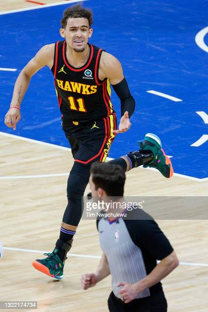 Trae Young of the Atlanta Hawks speaks with referee Ben Taylor during the second quarter during Game One of the Eastern Conference second round...