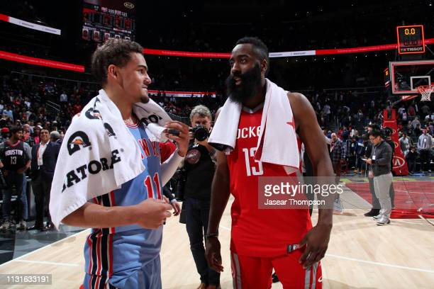 Trae Young of the Atlanta Hawks talks with James Harden of the Houston Rockets after the game on March 19 2019 at State Farm Arena in Atlanta Georgia...