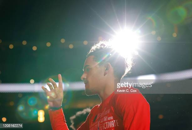 Trae Young of the Atlanta Hawks walks on the court during player introductions prior to facing the New York Knicks at State Farm Arena on February 09...