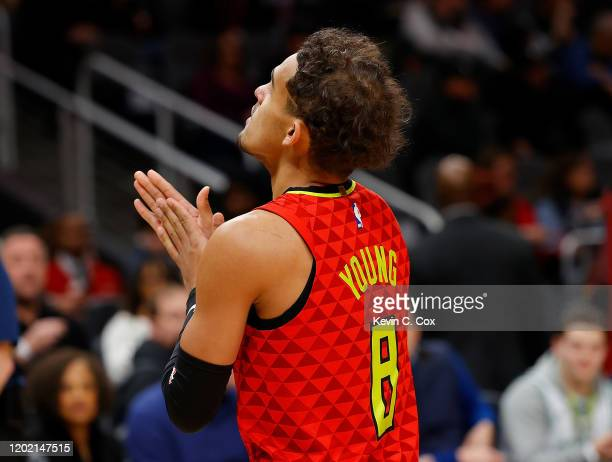 Trae Young of the Atlanta Hawks walks on the court wearing a jersey with the number 8 in memory of Kobe Bryant prior to facing the Washington Wizards...