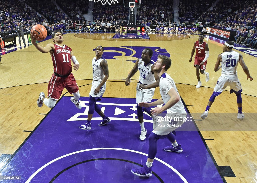 Trae Young #11 of the Oklahoma Sooners drives to the basked past Barry Brown #5 of the Kansas State Wildcats during the second half on January 16, 2018 at Bramlage Coliseum in Manhattan, Kansas.