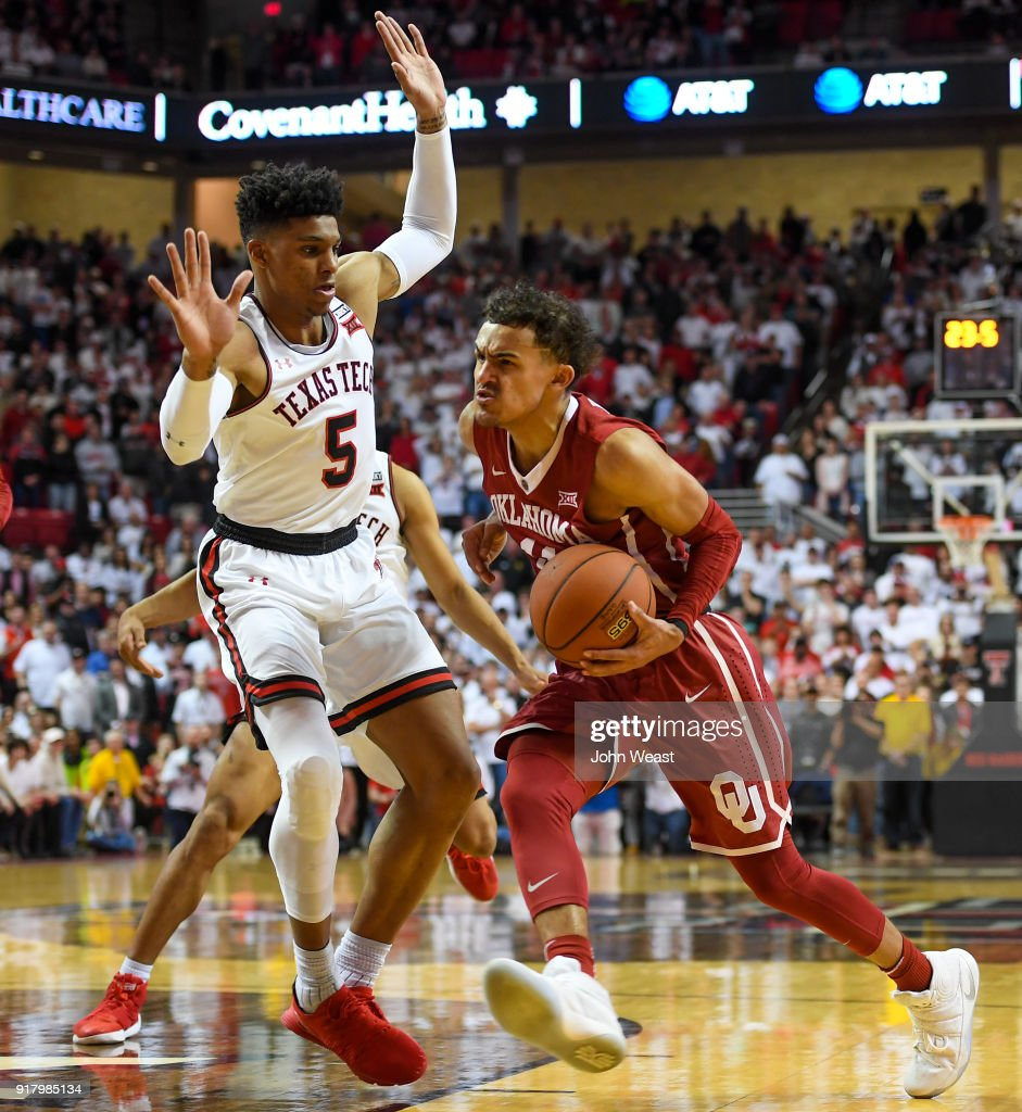 Trae Young #11 of the Oklahoma Sooners drives to the basket against Justin Gray #5 of the Texas Tech Red Raiders during the second half of the game on February 13, 2018 at United Supermarket Arena in Lubbock, Texas. Texas Tech defeated Oklahoma 88-78.