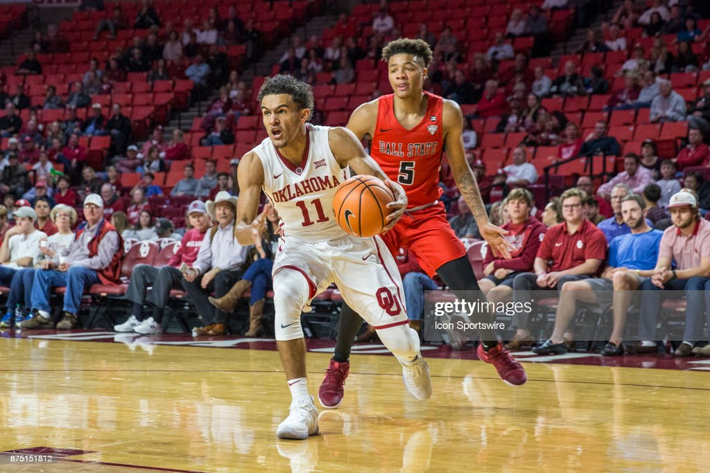 Trae Young (11) of the Oklahoma Sooners drives to the basket against Ishmael El-Amin (5) of the Ball State Cardinals during the Oklahoma Sooners against the Ball State Cardinals at the Lloyd Noble Center in Norman, Ok.