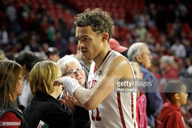 Trae Young of the Oklahoma Sooners greets fans after the game against the West Virginia Mountaineers at Lloyd Noble Center on February 5 2018 in...