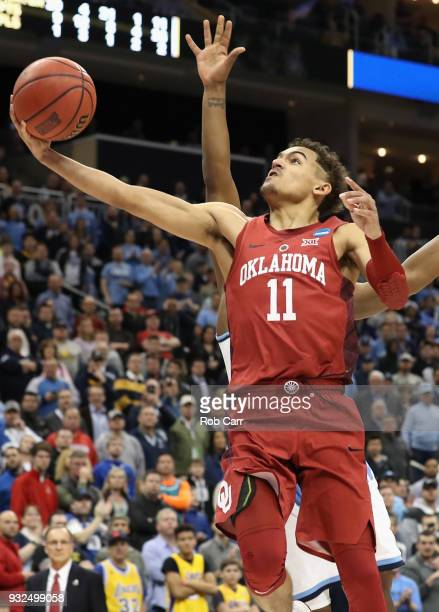 Trae Young of the Oklahoma Sooners lays up against the Rhode Island Rams in the second half of the game during the first round of the 2018 NCAA Men's...