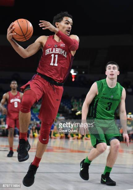 Trae Young of the Oklahoma Sooners looks to pass the ball as Payton Pritchard of the Oregon Ducks defends during the first half of the game during...