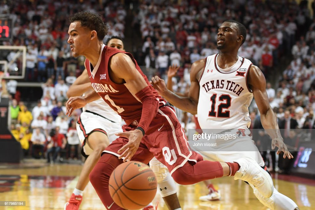 Trae Young #11 of the Oklahoma Sooners loses control of the ball against Keenan Evans #12 of the Texas Tech Red Raiders during the second half of the game on February 13, 2018 at United Supermarket Arena in Lubbock, Texas. Texas Tech defeated Oklahoma 88-78.