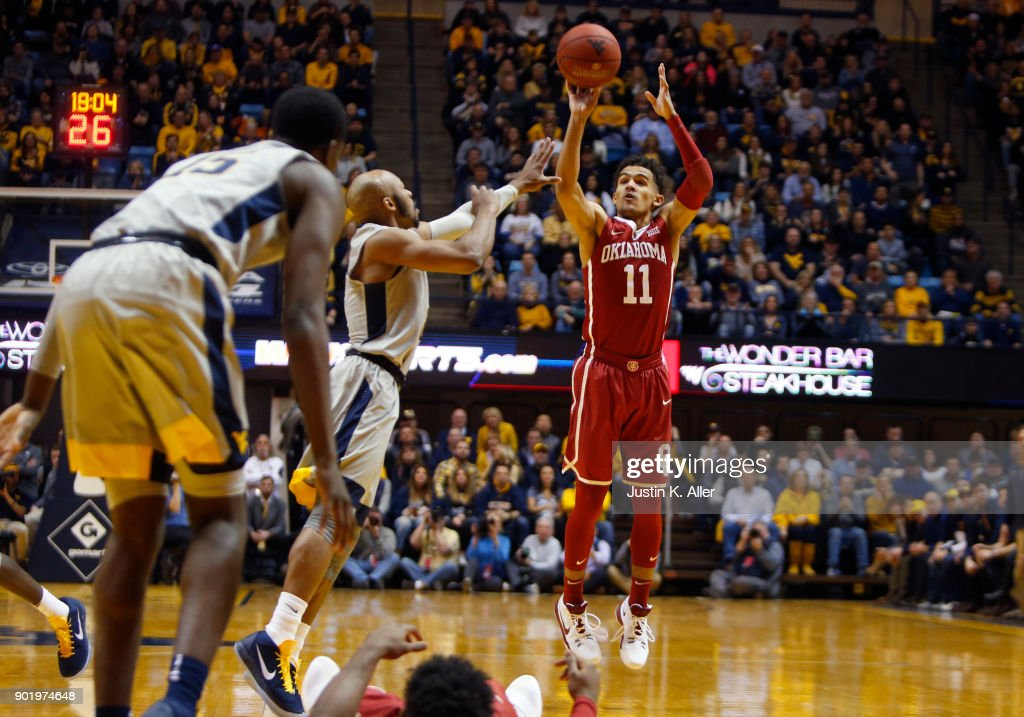 Trae Young #11 of the Oklahoma Sooners pulls up for three against the West Virginia Mountaineers at the WVU Coliseum on January 6, 2018 in Morgantown, West Virginia.