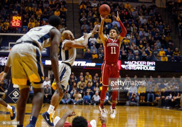 Trae Young of the Oklahoma Sooners pulls up for three against the West Virginia Mountaineers at the WVU Coliseum on January 6 2018 in Morgantown West...