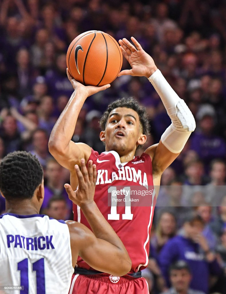 Trae Young #11 of the Oklahoma Sooners puts up a shot against Brian Patrick #11 of the Kansas State Wildcats during the first half on January 16, 2018 at Bramlage Coliseum in Manhattan, Kansas.