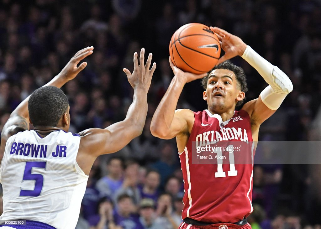 Trae Young #11 of the Oklahoma Sooners shoots the ball against Barry Brown #2 of the Kansas State Wildcats during the first half on January 16, 2018 at Bramlage Coliseum in Manhattan, Kansas.