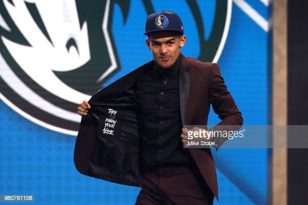 Trae Young reacts after being drafted fifth overall by the Dallas Mavericks during the 2018 NBA Draft at the Barclays Center on June 21 2018 in the...