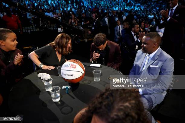 Trae Young reacts after being selected number five overall by the Dallas Mavericks on June 21 2018 at Barclays Center during the 2018 NBA Draft in...