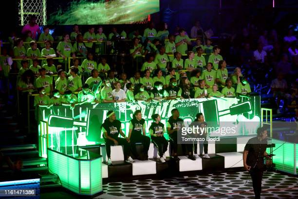 Trae Young Shaun White Alysa Liu Kel Mitchell and Nyjah Huston participate in a challenge onstage during Nickelodeon Kids' Choice Sports 2019 at...