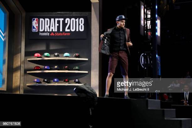 Trae Young walks the stage after being selected number five overall by the Dallas Mavericks on June 21 2018 at Barclays Center during the 2018 NBA...