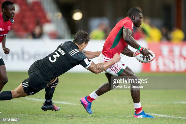 Trael Joass of New Zealand tries to tackle Bush Mwale of Kenya who runs with the ball during the match New Zealand vs Kenya Day 2 of the HSBC...