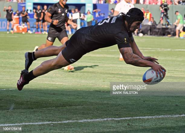 TOPSHOT Trael Mikkelson of New Zealand men's rugby team dives to score a try before defeating England 3312 in the Championships Final during the...