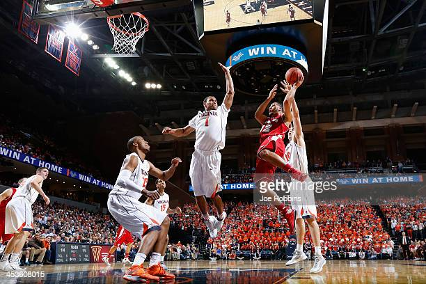 Traevon Jackson of the Wisconsin Badgers drives to the basket against Justin Anderson of the Virginia Cavaliers during the first half of the Big...