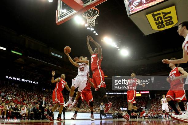 Traevon Jakcson of the Wisconsin Badgers drives to the hoop during the first half of play against the Ohio State Buckeyes at Kohl Center on February...