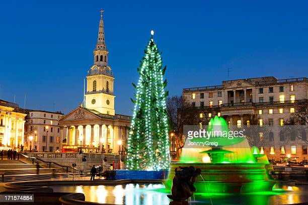 trafalgar square london at christmas - christmas scenes stock photos and pictures