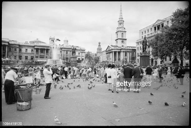 Trafalgar Square, Westminster, London, circa 1955-circa 1980. A view of Trafalgar Square, named such in 1830, filled with visitors and vendors, and...