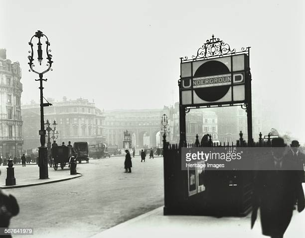 Trafalgar Square with Underground entrance and Admiralty Arch behind London 1913 Bowlerhatted office workers by the entrance to the tube at Trafalgar...