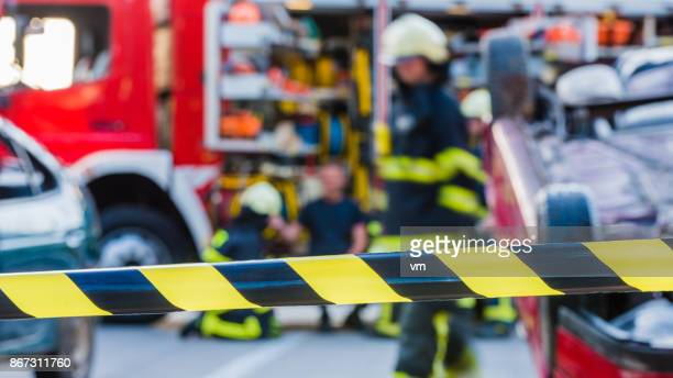 traffic accident scene - cordon tape stock pictures, royalty-free photos & images