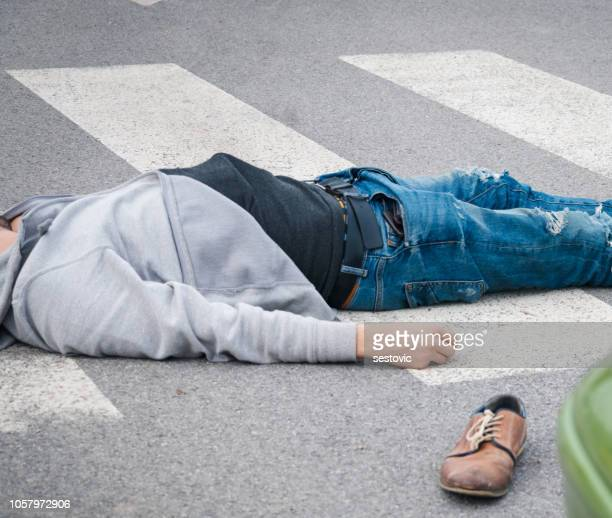 traffic accident. young man hit by a car - of dead people in car accidents stock pictures, royalty-free photos & images