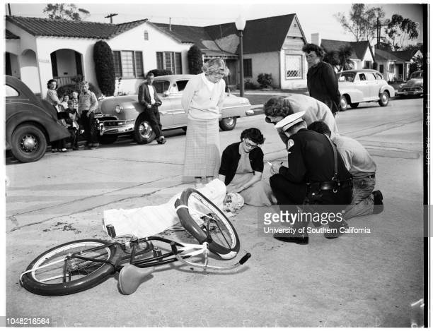 Traffic accidentCheviot Hills10533 Butterfield Road 05 March 1952 Jerry Noorda 7 years Mrs Henry Noorda Caption slip reads 'Photographer Sandusky...