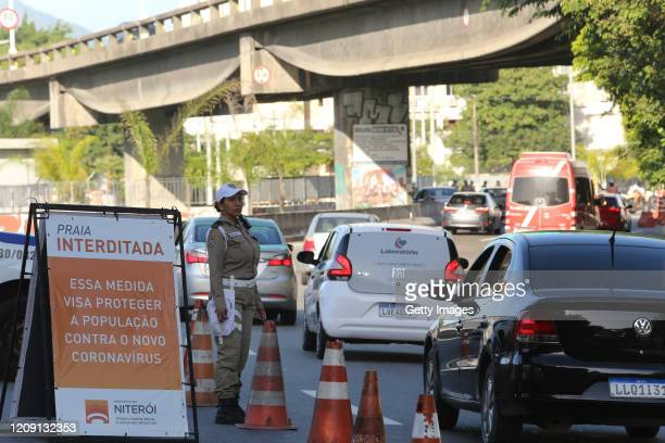 Traffic agents set up a blockade on the border between the municipalities of Sao Goncalo and Niteroi during the coronavirus pandemic on April 4, 2020...