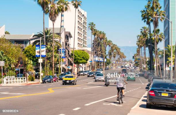traffic along washington boulevard in venice los angeles california - boulevard stock pictures, royalty-free photos & images