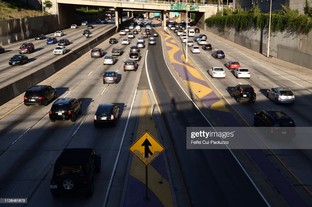 Traffic and merge road sign at city of Los Angeles, USA : Stock Photo