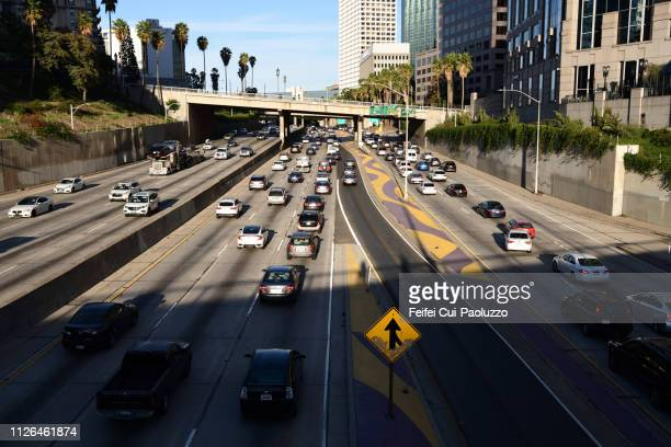 Traffic and merge road sign at city of Los Angeles, USA