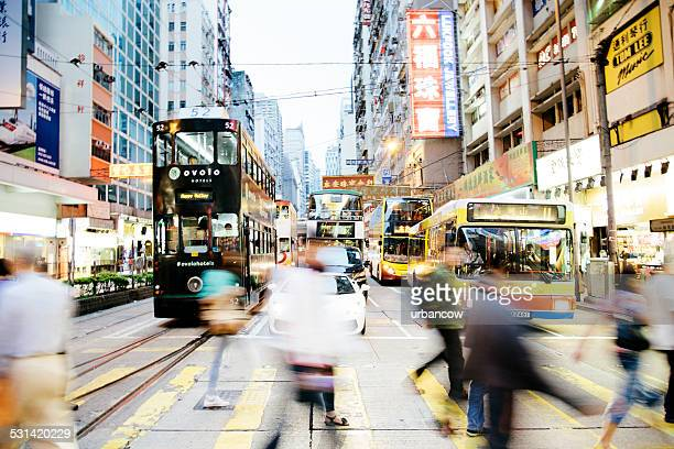 traffic and pedestrians on hennessy road, causeway bay, hong kong - wanchai stock photos and pictures