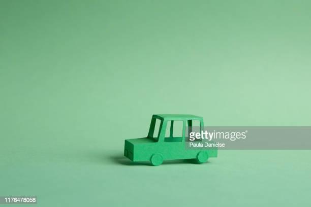 traffic and pollution concept - origami foto e immagini stock
