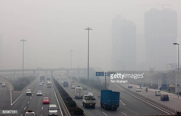 Traffic and pollution on motorway near the financial district of Xian China