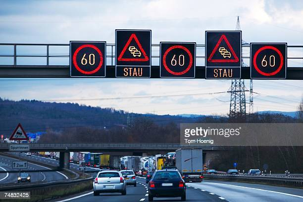 Traffic and speed limit signs on freeway