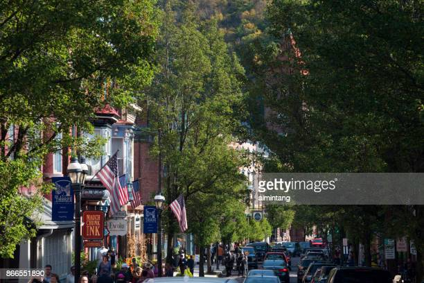 traffic and tourists filled broadway street in downtown jim thorpe - jim thorpe pennsylvania stock photos and pictures