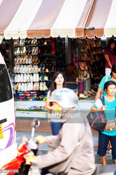 Traffic and waiting thai people on street