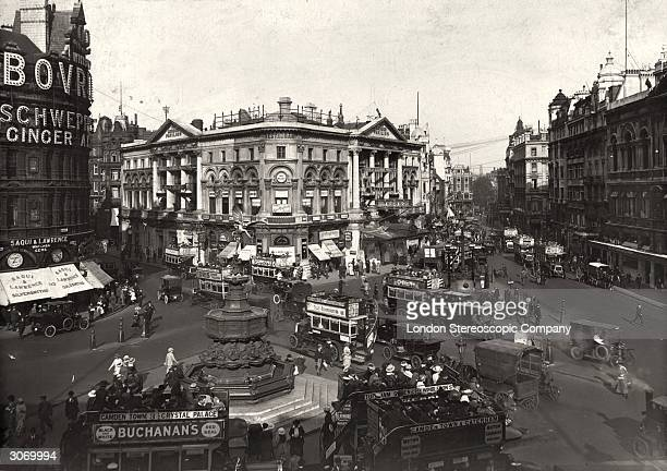 Traffic around the statue of Eros in Piccadilly Circus London